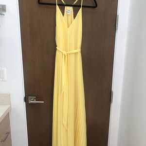 Pale yellow pleated maxi dress
